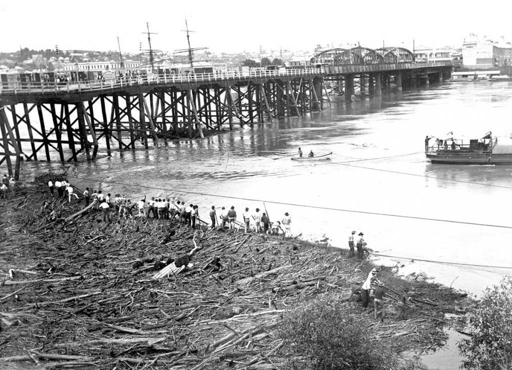 Richards4 Debris being cleared from the temporary wooden section of the Victoria Bridge in 1896