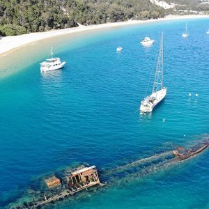 Wreck, boats, scuba divers and campers at Tangalooma Moreton Island © Regatta Marine